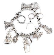 Sale 8915 - Lot 321 - A SILVER CHARM BRACELET; belcher links attached with 12 assorted charms with heart shape padlock clasp, length 19cm, wt. 51.95g.