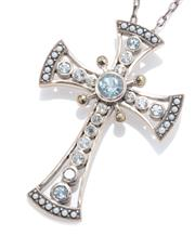 Sale 8965 - Lot 397 - A SILVER GEMSET CRUCIFORM PENDANT NECKLACE; collet set with round cut light blue topaz and 4 marcasites to edges set with seed pearl...