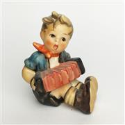 Sale 8456B - Lot 60 - Hummel Figure of a Boy with Accordian