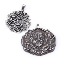 Sale 9194 - Lot 575 - TWO SILVER PENDANTS; 3 roses with humming brid, size 48 x 37mm, other featuring Ganesh, size 50 x 50mm, total wt. 31.62g.