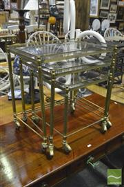 Sale 8398 - Lot 1043 - Brass Nest of Three Tables with Glass Tops on Castors