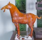 Sale 8677B - Lot 827 - A tang style horse with a burnt toffee drip glaze , H x 37cm