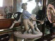 Sale 8730B - Lot 46 - German Ceramic Figure Depicting a Farmboy Restraining a Cow H: 18m