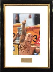 Sale 8125 - Lot 13 - Michael Klim, signed photograph, framed with plaque inset, size 30 x 19.5cm