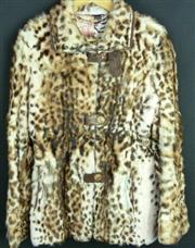 Sale 7982B - Lot 34 - Italian dyed fur jacket with leather button detail and printed lining (M)
