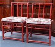 Sale 8815A - Lot 70 - A pair of red lacquered bamboo Chinese chairs with tie on cushions (af)