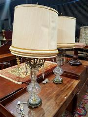 Sale 8693 - Lot 1076 - Pair of Baluster Shaped Crystal and Brass Table Lamps, with floral design, scrolled branches & with cream shades
