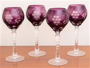 Sale 8891H - Lot 40 - A set of four amethyst cased hock glasses, each height 21cm