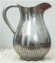 Sale 9066H - Lot 19 - An Indian silvered baluster shape water jug with gadrooned base. H 18cm