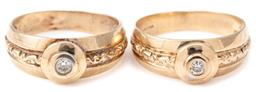 Sale 9124 - Lot 338 - A PAIR OF 9CT GOLD DIAMOND RINGS; each 7.5mm wide, tapered shank rub set with a round brilliant cut diamond of approx. 0.06ct to dec...