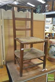 Sale 8267 - Lot 1077 - French Cherrywood Highchair, with two levels of rush seats, the upper being hinged