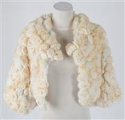 Sale 8541A - Lot 33 - A cream rosette fur cropped jacket, size S-M