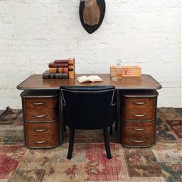 Sale 9245T - Lot 80 - An Art Deco style partners desk in solid fruit wood, with a floating top design, with aged gunmetal frame, with six conventional dra...