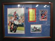 Sale 8125 - Lot 19 - Large framed collage showing World Motorbike Champion Michael Doohan, signed