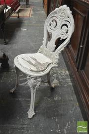 Sale 8291 - Lot 1057 - Possibly Victorian Cast Iron Garden Chair, painted white, with ornate balloon back, loose drop-in timber seat & on three legs joined...