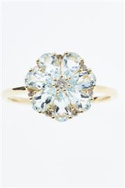 Sale 8315 - Lot 363 - AN 18CT GOLD GEMSET FLORAL CLUSTER RING; set with 7 pear cut aquamarines and 8 round brilliant cut diamond totalling 0.13ct, size N-O.