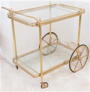 Sale 8369A - Lot 35 - A brass and glass two tiered tray mobile, H 76 x L 75cm