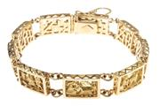 Sale 8574 - Lot 335 - AN 18CT GOLD BRACELET; plaque links with Peruvian scenes in high relief to box clasp with safety chain and clip, length 20cm, wt. 39...