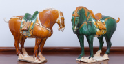 Sale 8677B - Lot 873 - A pair of Tang style horses, H 35cm