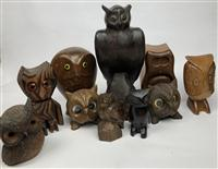 Sale 8725A - Lot 64 - A large and impressive rosewood sculpture of an owl, height 29cm (damage to ear) together with a quantity of timber and wicker owls...