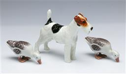 Sale 9098 - Lot 392 - Royal Doulton terrier figure (HN1014, H10cm) together with a pair of B&G geese (L9cm)