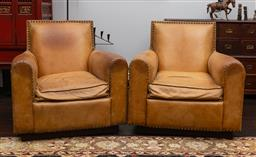 Sale 9160H - Lot 99 - A pair of toffee coloured leather Ralph Lauren club chairs, raised on a plinth base, with studded and stitched detailings, Height of...