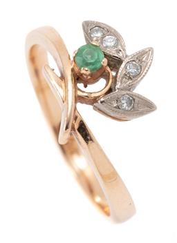 Sale 9194 - Lot 309 - A 14CT GOLD DIAMOND AND GEMSET RING; cross over band set with a round cut synthetic emerald to 3 rhodium plated stylised leaves set...