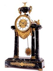 Sale 8362A - Lot 18 - A late Empire mantle clock, made in France circa 1850; With marble frame raised on bronze feet and bronze trims finely engraved, two...