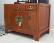 Sale 8677B - Lot 874 - A Chinese elm three drawer, two door cabinet fitted with brass hardware and shelved interior, H x 93cm, W x 126, D x 78cm