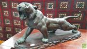 Sale 8402 - Lot 1009 - Japanese Meiji Bronze Tiger, set with glass eyes, seal mark underneath & on loose timber base