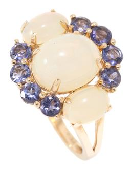 Sale 9177 - Lot 370 - AN OPAL AND GEMSTONE RING; set in silver gilt with 3 oval cabochon Ethiopian opals and 8 round cut tanzanites, size M, top 16mm wide...