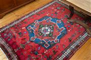 Sale 8270 - Lot 75 - A Persian Hamadan carpet, with red ground with geometric motif, 213 x 155cm