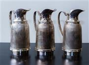Sale 8310A - Lot 23 - Three EP flasks with stoppers. Height 24cm