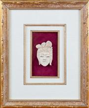 Sale 8308A - Lot 161 - A gilt framed antique Oriental carved ivory face, size approx 9cm, measurement with frame H 38 x W 31cm
