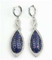 Sale 8482 - Lot 380 - A PAIR OF 18CT WHITE GOLD SAPPHIRE AND DIAMOND DROP EARRINGS; each a 55mm drop invisible set with 71 French and mixed cut blue sapph...