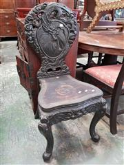 Sale 8814 - Lot 1075 - Heavily Carved Japanese Export Side Chair, the back carved probably with a view of Mt Fuji and flanked by a swirling dragon (repair...