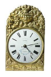 Sale 8828A - Lot 5 - Antique French clock dial and brass surround Combe salvaged from a comtoise clock and refitted with a quartz movement. Overall siz...