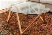 Sale 8863H - Lot 16 - A contemporary glasstop designer coffee table with oval glass top on zig zag timber base, Height 40cm, Length 130cm, Width 65cm
