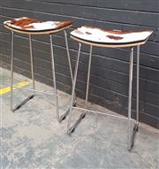 Sale 9043 - Lot 1086 - Pair of Modern Barstools with Cow Hide Top (h:70 x w:45 x d:32cm)