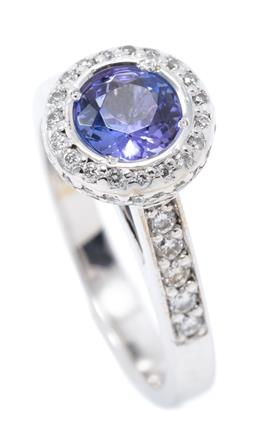 Sale 9168J - Lot 374 - A 18CT WHITE GOLD TANZANITE AND DIAMOND RING;  centring on an approx. 1.1ct round cut tanzanite to surround, claws, gallery and shou...