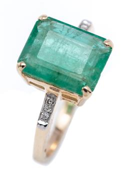 Sale 9194 - Lot 514 - A 14CT GOLD EMERALD AND DIAMOND RING; four claws set with an emerald cut emerald of approx. 3.52ct, to shoulders set with 4 round br...