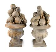 Sale 8422A - Lot 10 - A pair of cast stone baskets of fruit finials, small losses /chips, height 56cm