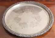 Sale 8470H - Lot 102 - A heavy gauge engraved EP circular tray with vine border, D 50cm
