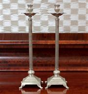 Sale 8815A - Lot 93 - A pair of white metal candlesticks with foliate drip trays on square form bases, Height 44cm