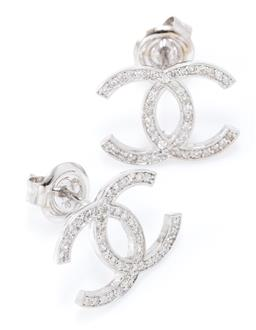 Sale 9168J - Lot 367 - A PAIR OF 18CT WHITE GOLD AND DIAMOND STUD EARRINGS; in the Chanel style each set with  mixed round brilliant and single cut diamond...