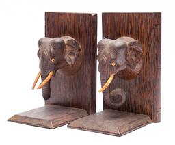 Sale 9170H - Lot 34 - A pair of elephant mask form bookends, some losses, height 18.5cm