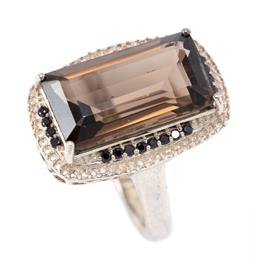 Sale 9177 - Lot 352 - A SILVER SMOKY QUARTZ AND STONE SET COCKTAIL RING; centring a step cut smoke quartz of approx. 8.30ct to surround set with 24 black...