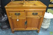 Sale 8262 - Lot 1002 - Chinese Two Door Two Drawer Cabinet on Raised Bracket Feet