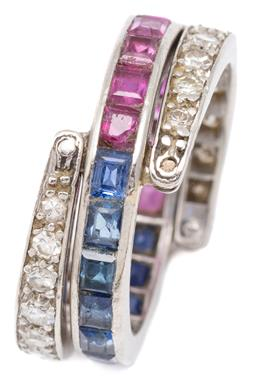 Sale 9132 - Lot 451 - A PLATINUM LATE DECO DIAMOND AND GEM SET SWIVEL RING; central 3mm wide band channel set with 11 each carre cut rubies and sapphires...