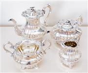 Sale 8369A - Lot 41 - A four piece Sheffield plate tea and coffee service in the Rococo style with floral finials, H of coffee pot 23cm